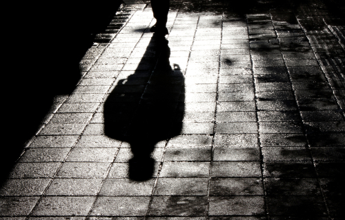 Dreams About Being Chased: shadow following someone