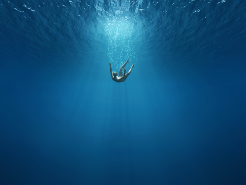 water in dreams: man falling into the depths of the sea